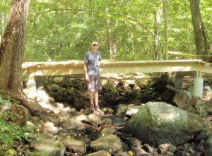 Shawn Clifton beside his bridge project.