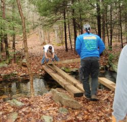 Getting stringers in place over Rocky Brook